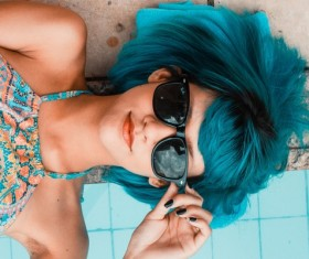 Blue hair with sunglasses woman Stock Photo