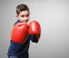 Boxing movement of the little boy Stock Photo