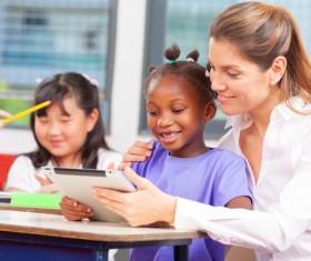 Female teachers and pupils Stock Photo 02