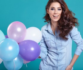 Hand holding a balloon smiling woman Stock Photo