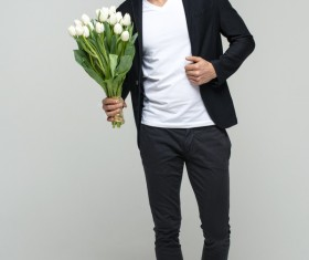 Handsome young male holding flowers Stock Photo