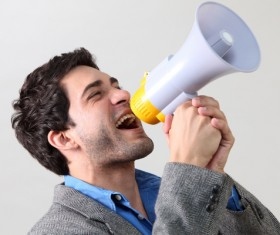 Holding a horn loud people Stock Photo 09