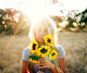 Holding sunflower flowers back light girl Stock Photo