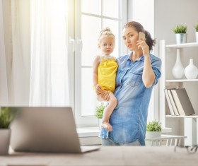 Holding the childs mother answered the phone Stock Photo