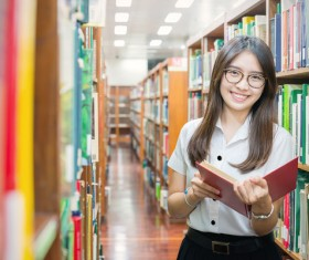 Library reading female student Stock Photo