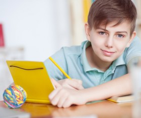 Little boy writing homework Stock Photo