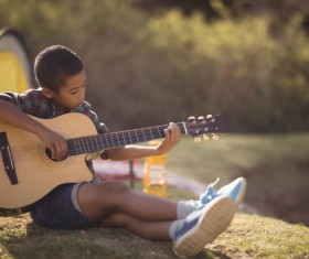 Play the guitar little boy Stock Photo