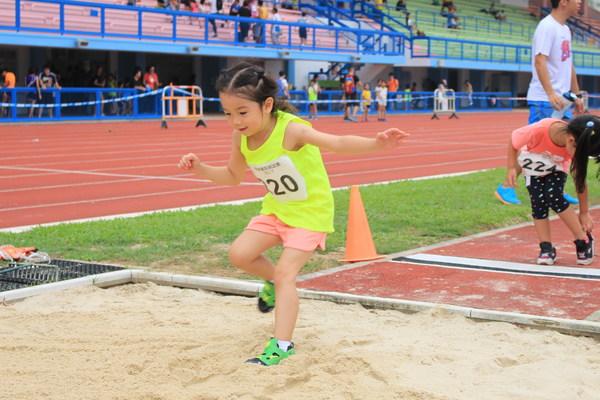 Pupils long jump Stock Photo