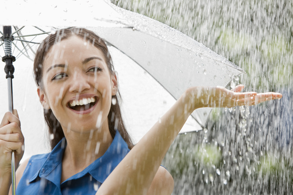 Rainy woman with umbrella happy Stock Photo 01