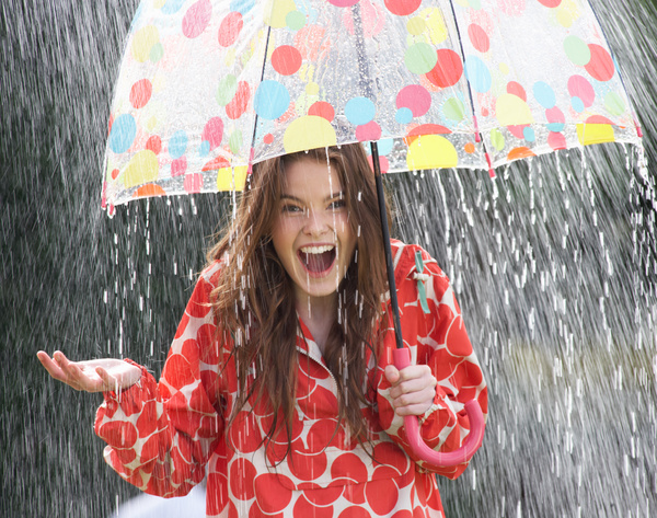 Rainy woman with umbrella happy Stock Photo 02