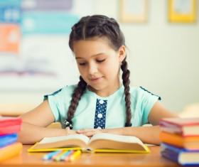 Reading the little girl Stock Photo