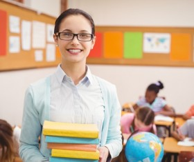 Smiling students holding books Stock Photo
