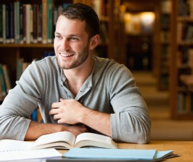 Smiling boys studying in the library Stock Photo