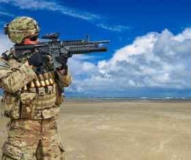 Soldiers armed with guns Stock Photo