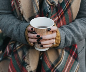 Stylish woman holding coffee cup in hands Stock Photo