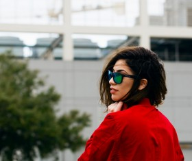 Stylish young woman with sunglasses and red shirt Stock Photo