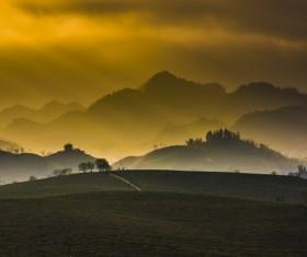Sun beams on beautiful highland landscape at dusk Stock Photo