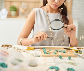 Take magnifying glass jewelry appraisers Stock Photo