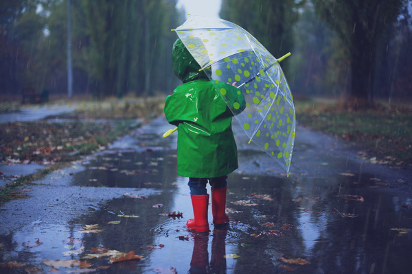The little girl with an umbrella on rainy day Stock Photo 03