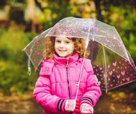 The little girl with an umbrella on rainy day Stock Photo 04