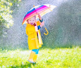 The little girl with an umbrella on rainy day Stock Photo 05