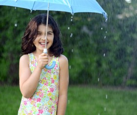 The little girl with an umbrella on rainy day Stock Photo 07