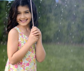 The little girl with an umbrella on rainy day Stock Photo 08