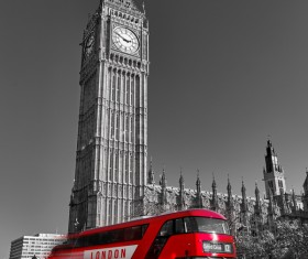 The red bus passing through Big Ben Stock Photo