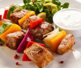 Vegetable skewers with sauce Stock Photo