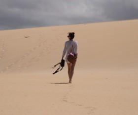 Walking girls in the desert Stock Photo