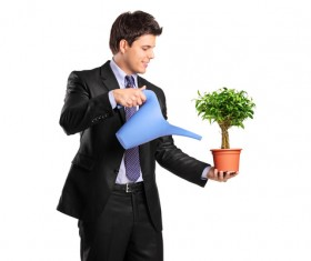 Water the plant young man Stock Photo