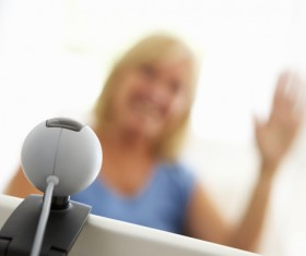 Webcam conversation via computer technology Stock Photo 04