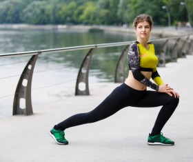girl who does stretching exercises Stock Photo