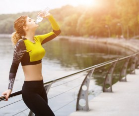 girl who drinks water after exercising Stock Photo 01