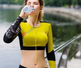 girl who drinks water after exercising Stock Photo 02