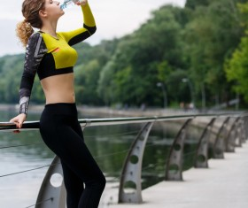 girl who drinks water after exercising Stock Photo 03