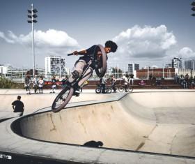 man extreme with bicycle acrobat performance Stock Photo