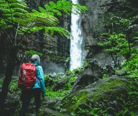 mountain climber who sees the mountain waterfall Stock Photo
