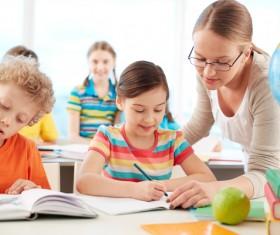 teacher who coaches students Stock Photo 01