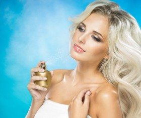 woman who sprays perfume Stock Photo 01