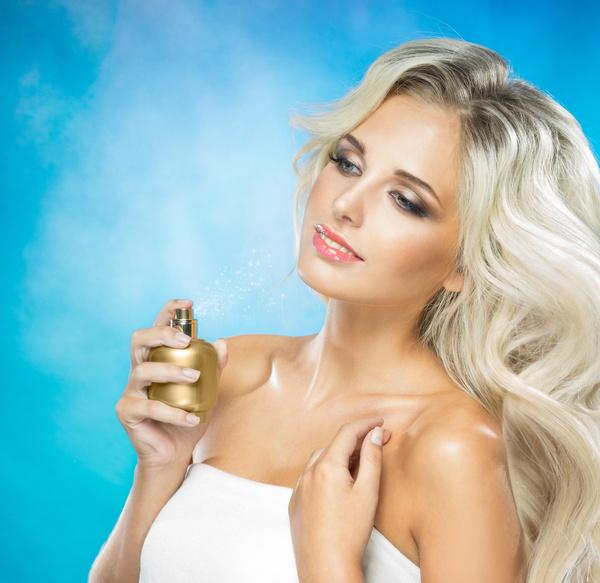 woman who sprays perfume Stock Photo 01
