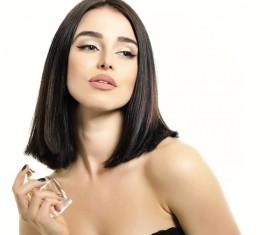 woman who sprays perfume Stock Photo 03