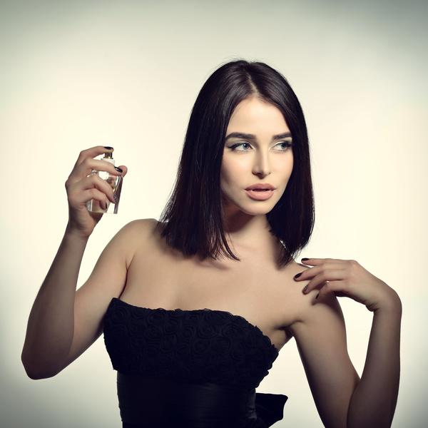 woman who sprays perfume Stock Photo 04