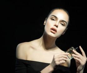 woman who sprays perfume Stock Photo 05