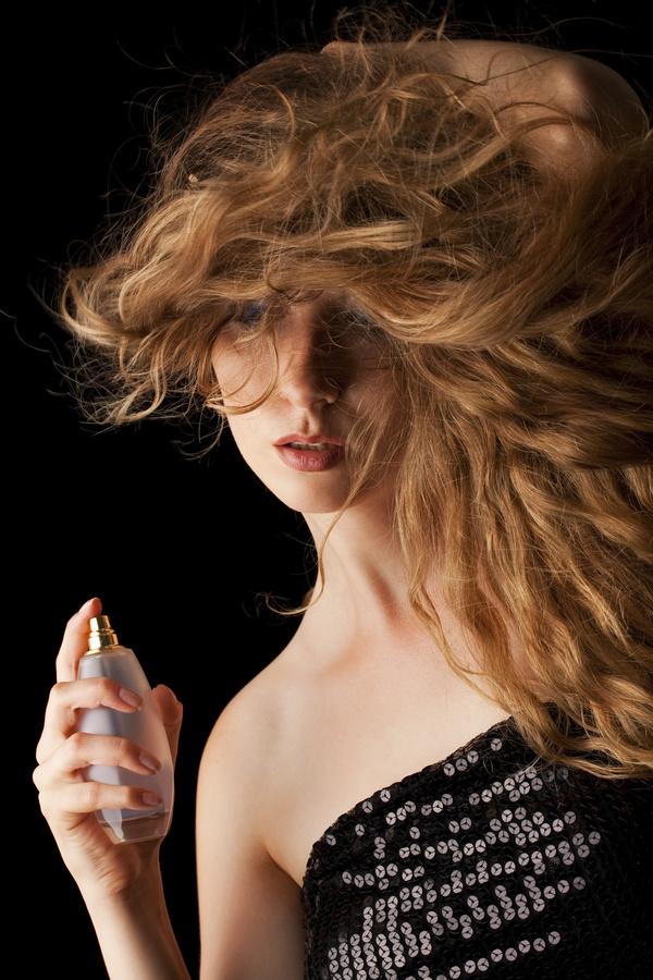 woman who sprays perfume Stock Photo 09