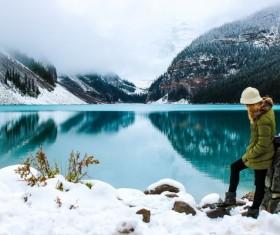 A woman enjoying the beauty of winter lake Stock Photo