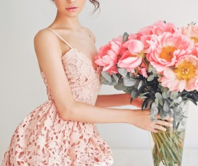 Beautiful young woman with bouquet of peony Stock Photo 01