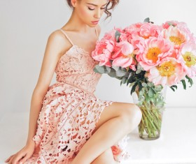 Beautiful young woman with bouquet of peony Stock Photo 02