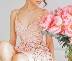 Beautiful young woman with bouquet of peony Stock Photo 03