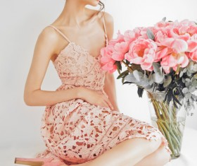 Beautiful young woman with bouquet of peony Stock Photo 05